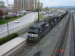 NS 9705 & NS 9204 tow a steel slab Gondola Train WB
