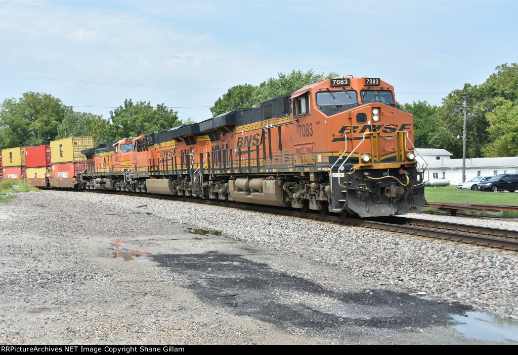 BNSF 7083 Drags a stack uphill.