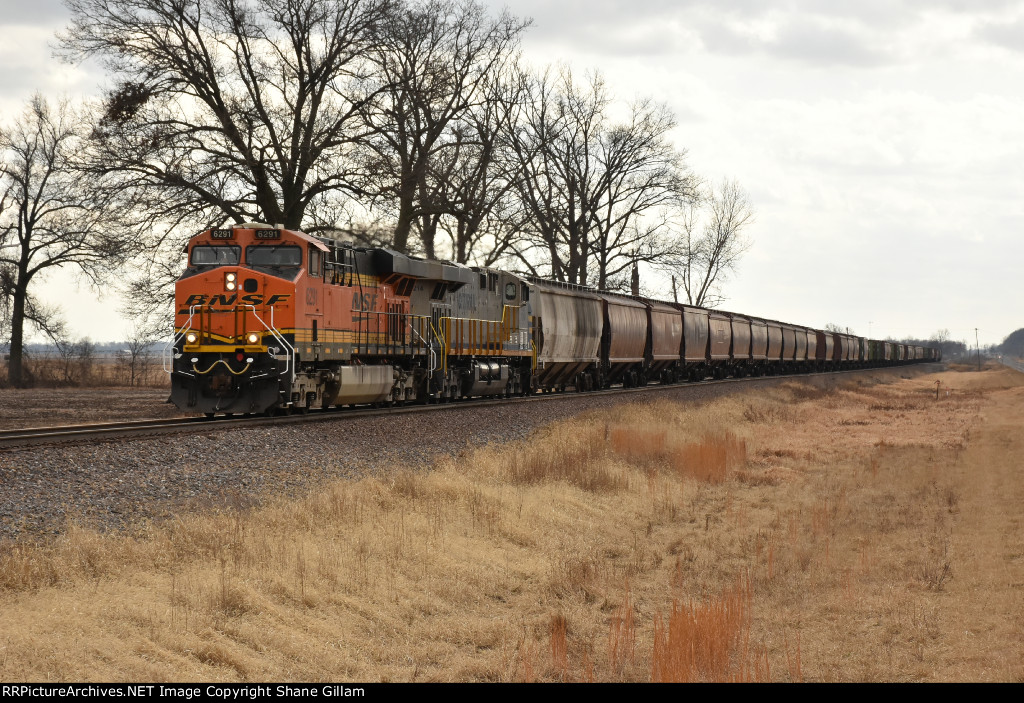 BNSF 6291 Leads a short grain up the K line.
