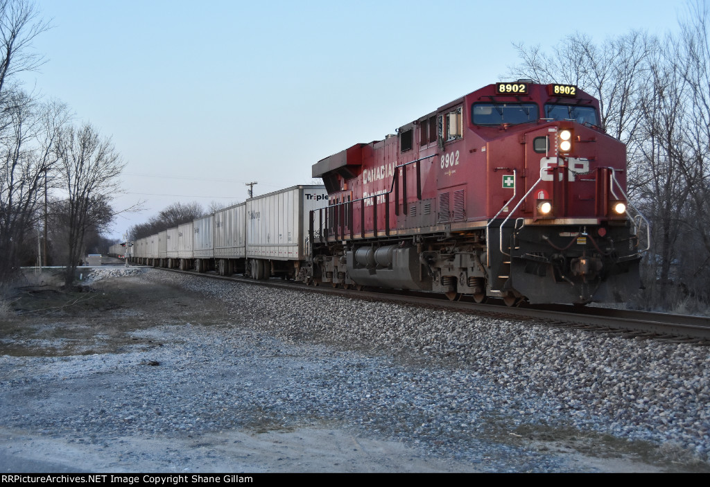 CP 8902 leads Ns 255 west in the evening light.