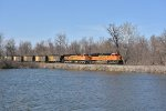 BNSF 8775 Crawls past a small pond.