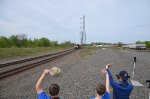 Railfans wave to the oncoming NS 62V!