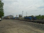 Looking East at Yard, Building & Track Equipment &  Azcon GMTX Switcher 75 & 73