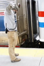 Rennselaer Utility Conductor giving hand signals for the hitch