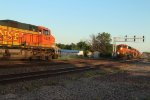 Northbound Auto Racks led by BNSF 6982 gets ready to attack the hill at dusk