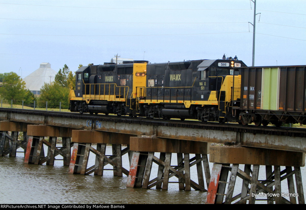 WAMX 3521 and slug 501 on the trestle leading into the Stillwater Central Yard