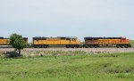 A BNSF and UP lash-up move a train west