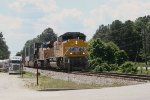 UP 8957 and 7209 approach the Roberts Rd crossing