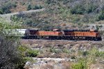 BNSF #6753, 7656 (ES-44C4, ES-44DC) are the DPUs of a westbound near Keenbrook Rd. in Cajon Pass, CA. July 17, 2018