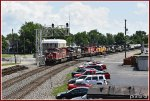 CP 8132 leads the colorful and plentiful mixer across Center St.