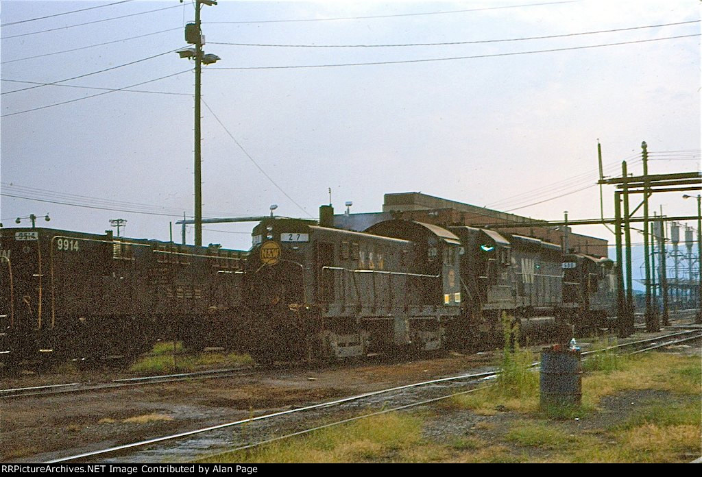 NW T-6 27 waits for assignment beside yard slug 9914