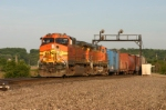 BNSF 4136 brings a manifest down the hill on Track 1
