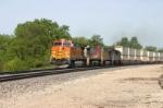 BNSF 4495 has a Q train under control