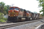 BNSF 7676 leads a Med Shipping train