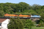 BNSF 4130 leads an empty taconite train north over houses and the CNW