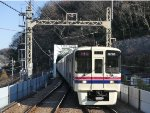Pulling into Takao station