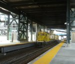 Metro-North BL14CGs 401 & 402 towing four flatcars through Yankee Stadium-East 153 Street Station