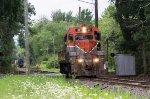 HRRC 22, ex-Bangor & Aroostook crosses Sand Road after coupling a string of covered hoppers to what will become train NX-13