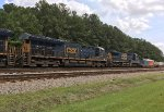 CSX 3318, 3438, and 7920 push a stack train