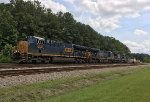 CSX 3318, 3438, and C40-8W 7920 (LMS 702) push a stack train