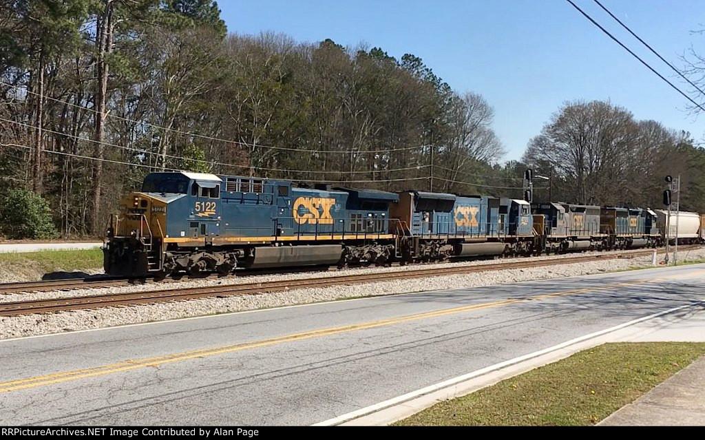 CSX 5122 leads a trio of EMD's past the Union City signals