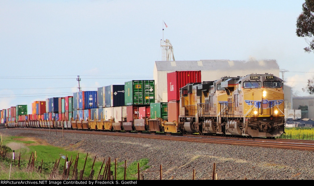 UP 7359 leads a stack train southbound