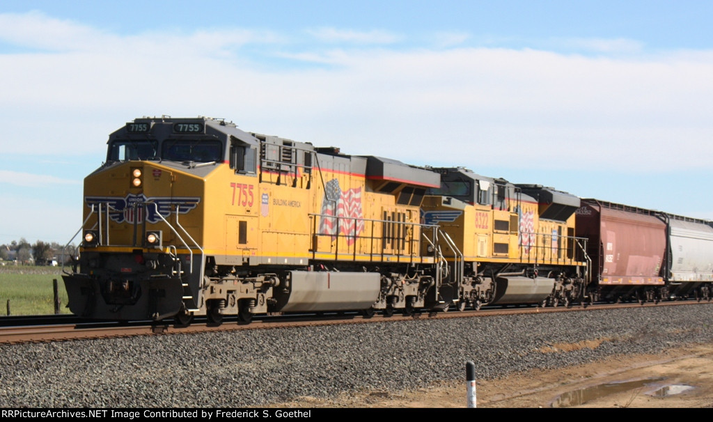 UP 775 leads northbound with an empty unit grain train heading back eastward