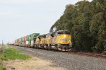 UP 8805 pulls a long container train southbound