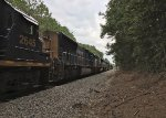 CSX 3473 leads 8 units and an F40PHM-2 in tow across Gordon St