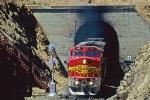 A 2-971 train exits tunnel 9