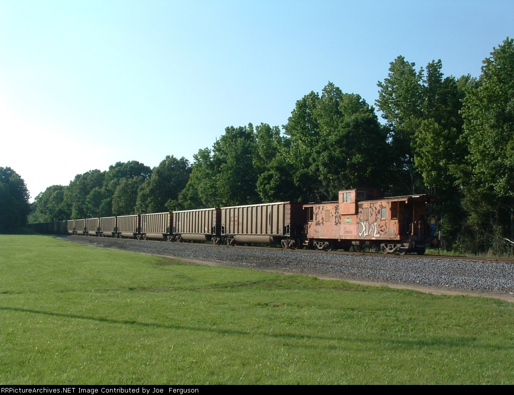 "IC 199000 is the ""leader"" as an empty coal train backs down the BNSF line to Burlington Jct., where it will then go north back to the mine on the Edgewood Cutoff"