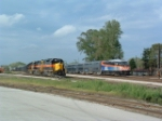 IAIS 715 waits out rush hour while Metra 406 speeds by (no station stop here)