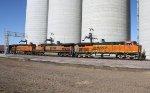 BNSF 7855, BNSF 1011, and BNSF 7259 on a Grain Train