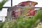 CP 8038 Through the Plants and Fence on Three Wide Road with the Cab of CN 3818 in the Background.