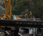 New deck span being attached to crane