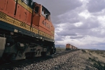 BNSF trains meet under threatening skies