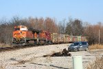 BNSF SB freight with pipe loads