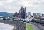 Trash empties pass the old blast furnace