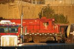 MNNR 75 continues working the yard in the golden light, glimpsed behind Lube-Tech