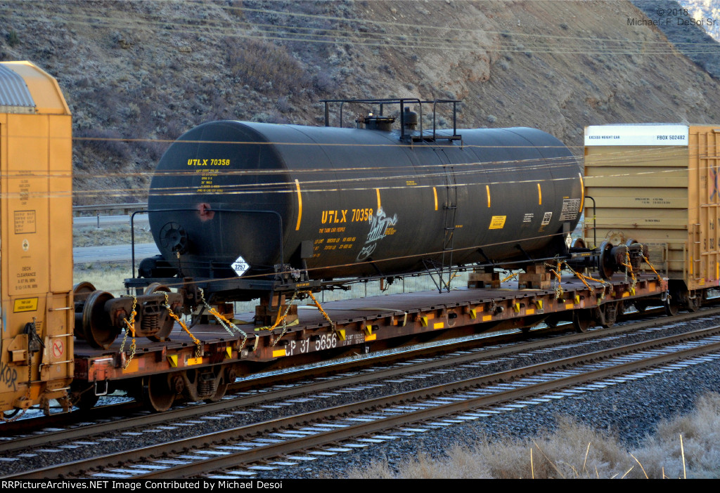 """""""A Different Kind Of TOFC""""  Tank car (UTLX #70358) on a flatcar (CP #315656) in a westbound UP freight in Echo, UT. October 13, 2018 {Echtoberfest}"""