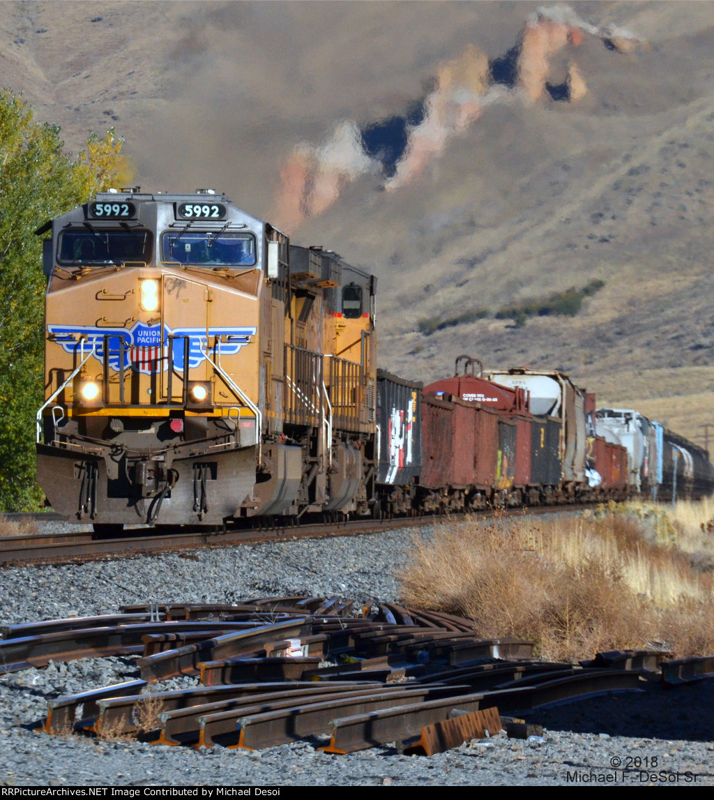 """With the famous """"Hoo Doos Of Echo"""" blurred by its exhaust, an eastbound UP freight (led by #5992 & 5657 , both AC-4400CWs) blasts though Echo. UT. October 13, 2018 {Echtoberfest 2018}"""