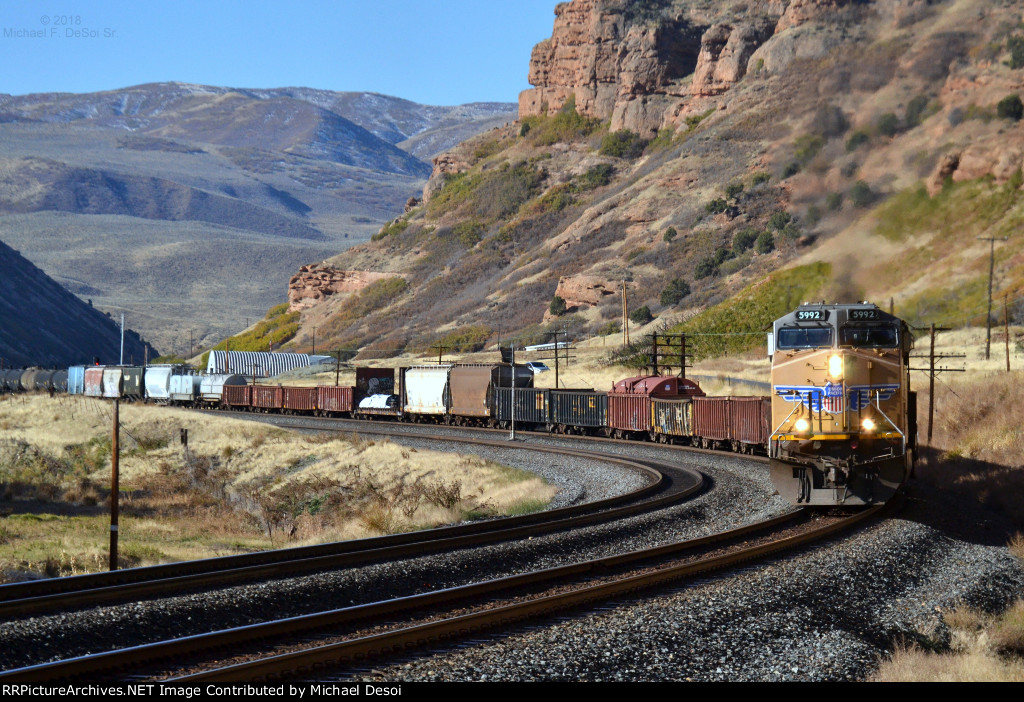 An eastbound UP freight (led by #5992 & 5657 , both AC-4400CWs) snakes its way though one of the many curves in Echo Canyon, just east of Echo. UT. October 13, 2018 {Echtoberfest 2018}