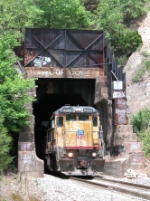 UP 9262 emerges from the tunnel