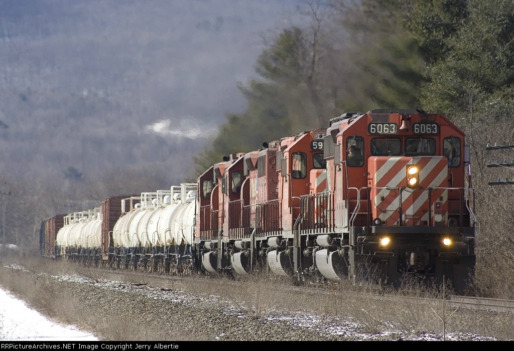 CP 6063 leads three old soldiers on train 413