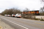 BNSF track crews and supervisors gathered by the locomotives.