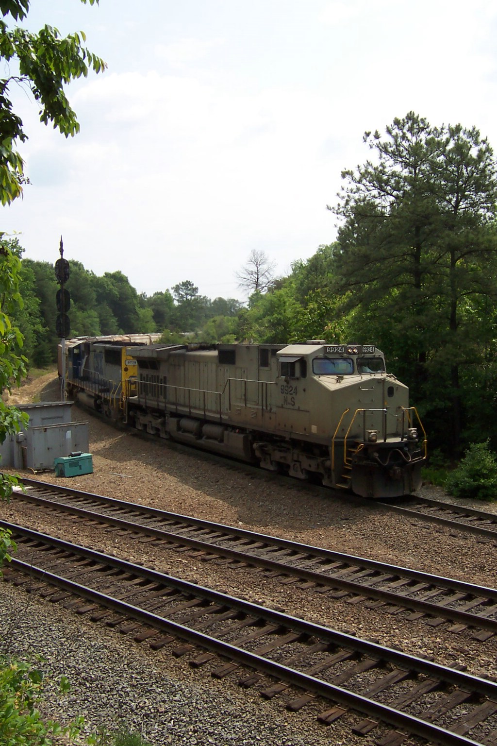 More surprises for today with a NS dash 9 leading a southbound grainer
