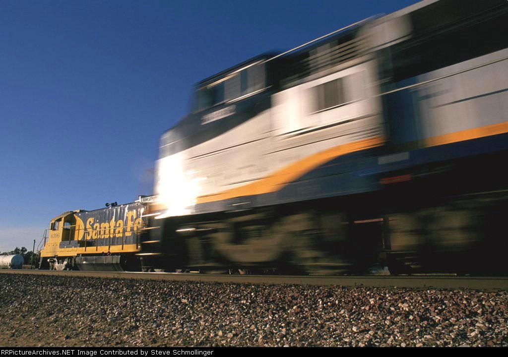 Westbound Amtrak San Joaquin passes Santa Fe B-boat