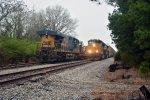 Q211 passing MOW train