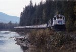 Rocky Mountaineer eastbound on the CP at Craigellachie BC, October 7, 1992. GE B36-7s for power.
