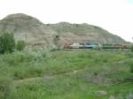 BNSF 8283 SD75I alongside Eastern Montana's finest gumbo hills